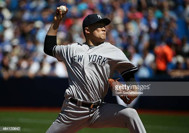 Masahiro Tanaka of the New York Yankees delivers a pitch in the first inning during MLB game action against the Toronto Blue Jays on August 15 2015...
