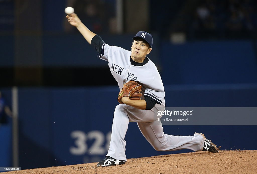 <a gi-track='captionPersonalityLinkClicked' href=/galleries/search?phrase=Masahiro+Tanaka&family=editorial&specificpeople=5492836 ng-click='$event.stopPropagation()'>Masahiro Tanaka</a> #19 of the New York Yankees delivers a pitch in the second inning during MLB game action against the Toronto Blue Jays on April 4, 2014 at Rogers Centre in Toronto, Ontario, Canada.
