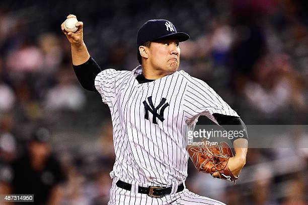 Masahiro Tanaka of the New York Yankees delivers a pitch in the second inning against the Baltimore Orioles at Yankee Stadium on September 8 2015 in...