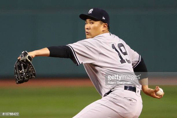 Masahiro Tanaka of the New York Yankees delivers in the first inning during game two of a doubleheader against the Boston Red Sox at Fenway Park on...