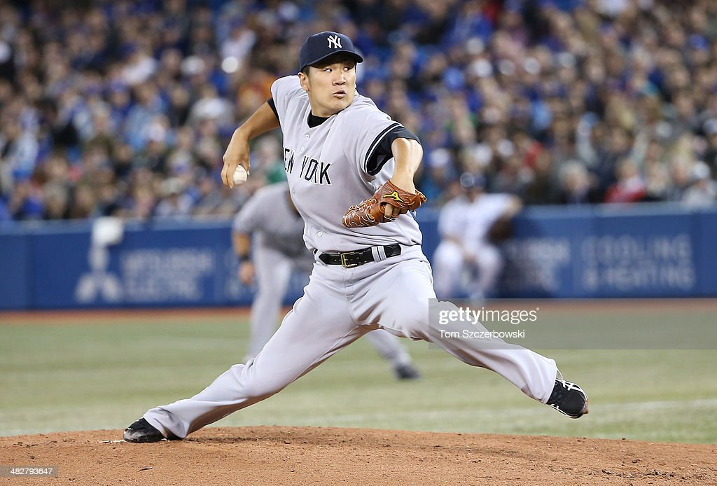 <a gi-track='captionPersonalityLinkClicked' href=/galleries/search?phrase=Masahiro+Tanaka&family=editorial&specificpeople=5492836 ng-click='$event.stopPropagation()'>Masahiro Tanaka</a> #19 of the New York Yankees delivers the first pitch of his MLB career in the first inning during MLB game action against the Toronto Blue Jays on April 4, 2014 at Rogers Centre in Toronto, Ontario, Canada.