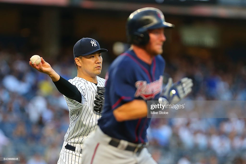 <a gi-track='captionPersonalityLinkClicked' href=/galleries/search?phrase=Masahiro+Tanaka&family=editorial&specificpeople=5492836 ng-click='$event.stopPropagation()'>Masahiro Tanaka</a> #19 of the New York Yankees fields a ground ball off the bat of Robbie Grossman #36 of the Minnesota Twins in the third inning for an out at Yankee Stadium on June 24, 2016 in the Bronx borough of New York City.