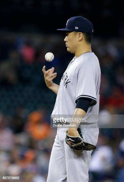 Masahiro Tanaka of the New York Yankees flips a baseball after giving up a home run to Nicholas Castellanos of the Detroit Tigers during the seventh...