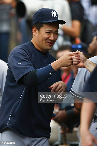 Masahiro Tanaka of the New York Yankees greets teammates in the dugout prior to playing against the St Louis Cardinals at Busch Stadium on May 28...