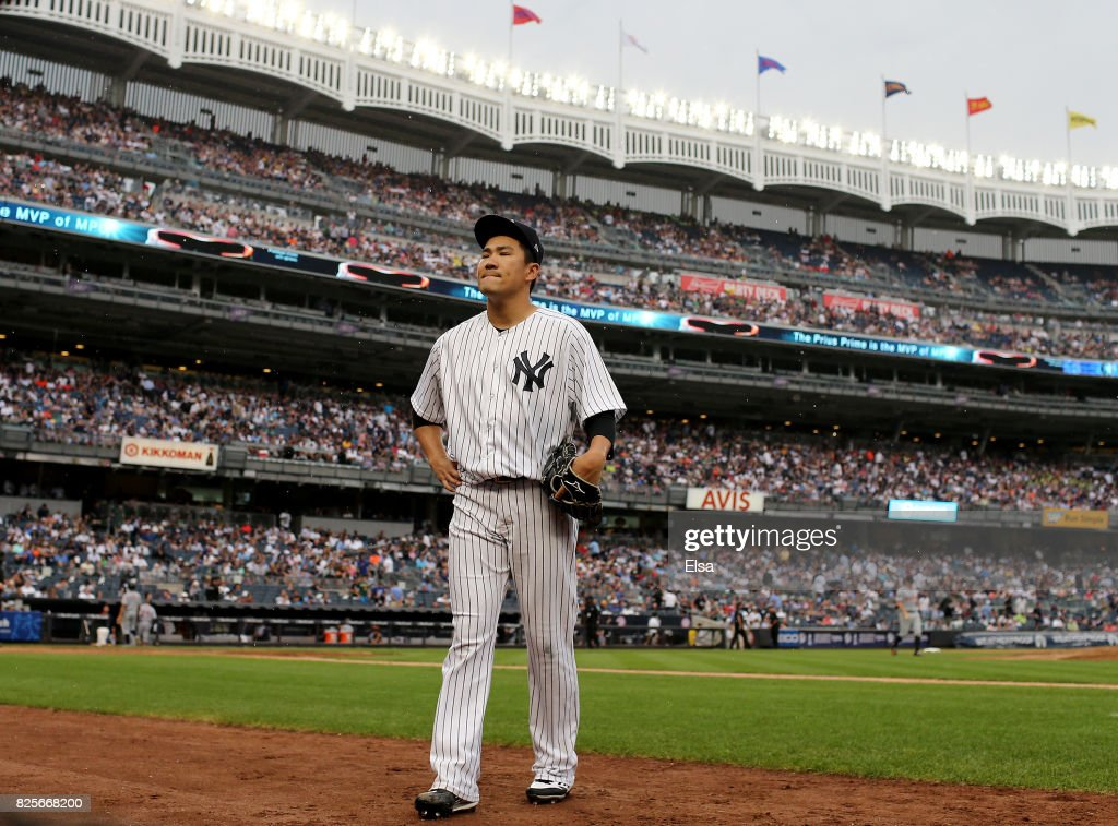 Masahiro Tanaka #19 of the New York Yankees heads for the dugout after the sixth inning against the Detroit Tigers on August 2, 2017 at Yankee Stadium in the Bronx borough of New York City.