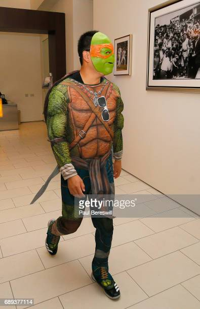 Masahiro Tanaka of the New York Yankees is dressed as Teenage Mutant Ninja Turtle Michelangelo as he walks in to meet the children at a Yankees...