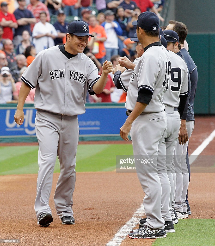 <a gi-track='captionPersonalityLinkClicked' href=/galleries/search?phrase=Masahiro+Tanaka&family=editorial&specificpeople=5492836 ng-click='$event.stopPropagation()'>Masahiro Tanaka</a> #19 of the New York Yankees is introduced before a game against the Houston Astros on opening day at Minute Maid Park on April 1, 2014 in Houston, Texas.