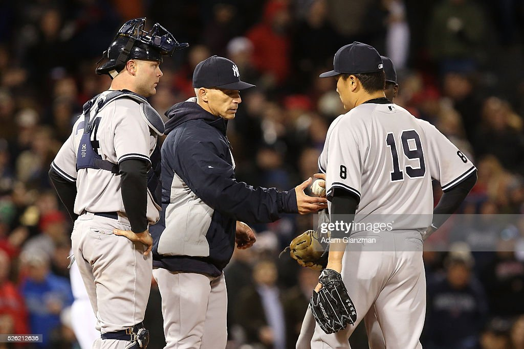<a gi-track='captionPersonalityLinkClicked' href=/galleries/search?phrase=Masahiro+Tanaka&family=editorial&specificpeople=5492836 ng-click='$event.stopPropagation()'>Masahiro Tanaka</a> #19 of the New York Yankees is pulled from the game by manager <a gi-track='captionPersonalityLinkClicked' href=/galleries/search?phrase=Joe+Girardi&family=editorial&specificpeople=208659 ng-click='$event.stopPropagation()'>Joe Girardi</a> in the seventh inning during the game against the Boston Red Sox at Fenway Park on April 29, 2016 in Boston, Massachusetts.