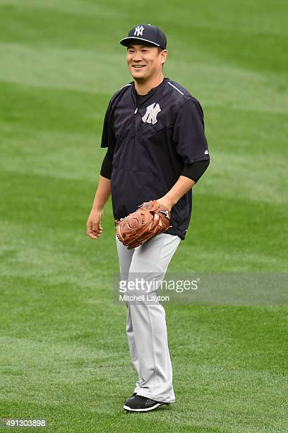 Masahiro Tanaka of the New York Yankees looks on before a baseball game against the Baltimore Orioles at Oriole Park at Camden Yards on October 4...