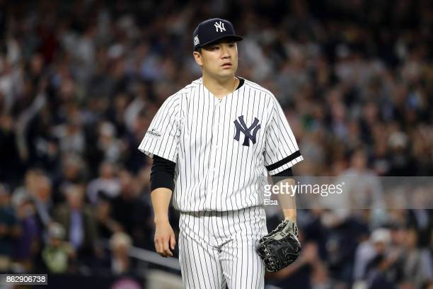 Masahiro Tanaka of the New York Yankees looks on during the seventh inning against the Houston Astros in Game Five of the American League...