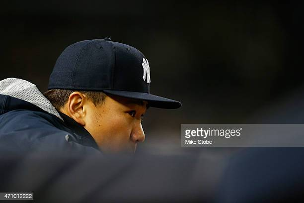 Masahiro Tanaka of the New York Yankees looks on from the bench in the ninth inning against the New York Mets on April 24 2015 at Yankee Stadium in...
