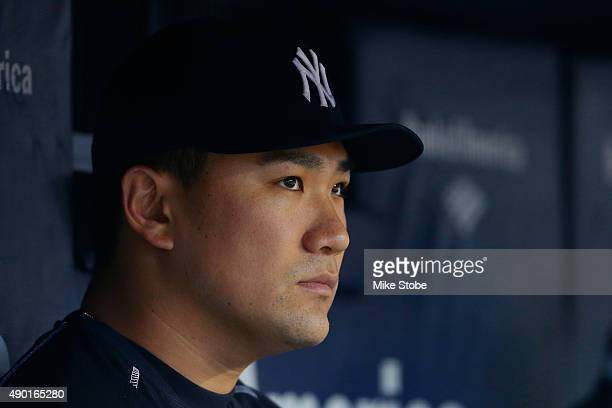 Masahiro Tanaka of the New York Yankees looks on from the dugout in the eighth inning against the Chicago White Sox at Yankee Stadium on September 26...