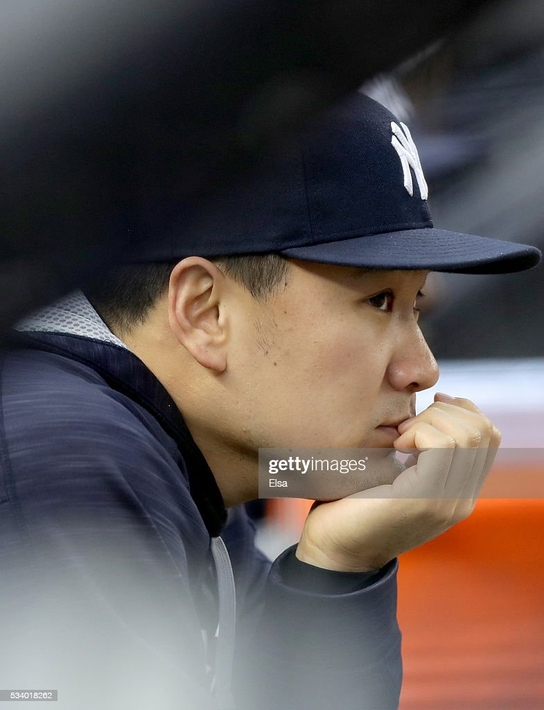 <a gi-track='captionPersonalityLinkClicked' href=/galleries/search?phrase=Masahiro+Tanaka&family=editorial&specificpeople=5492836 ng-click='$event.stopPropagation()'>Masahiro Tanaka</a> #19 of the New York Yankees looks on from the dugout before the game against the Toronto Blue Jays at Yankee Stadium on May 24, 2016 in the Bronx borough of New York City.