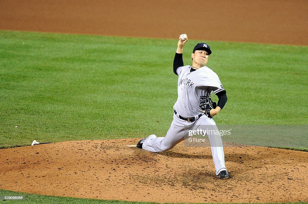 <a gi-track='captionPersonalityLinkClicked' href=/galleries/search?phrase=Masahiro+Tanaka&family=editorial&specificpeople=5492836 ng-click='$event.stopPropagation()'>Masahiro Tanaka</a> #19 of the New York Yankees pitches against the Baltimore Orioles at Oriole Park at Camden Yards on May 5, 2016 in Baltimore, Maryland.