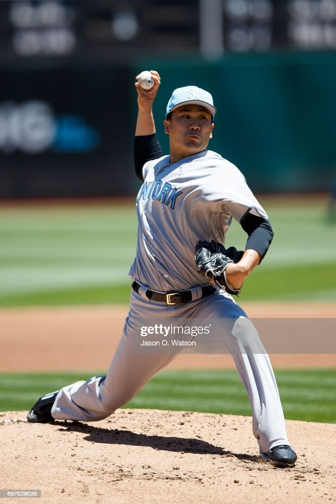 Masahiro Tanaka #19 of the New York Yankees pitches against the Oakland Athletics during the first inning at the Oakland Coliseum on June 17, 2017 in Oakland, California. Players and umpires are wearing blue to celebrate Father's Day weekend and support prostrate cancer awareness.