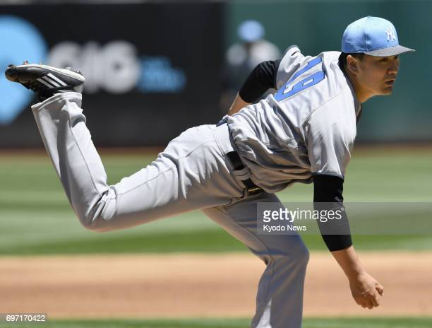 Masahiro Tanaka of the New York Yankees pitches against the Oakland Athletics at Oakland Coliseum in California on June 17 2017 Tanaka gave up five...