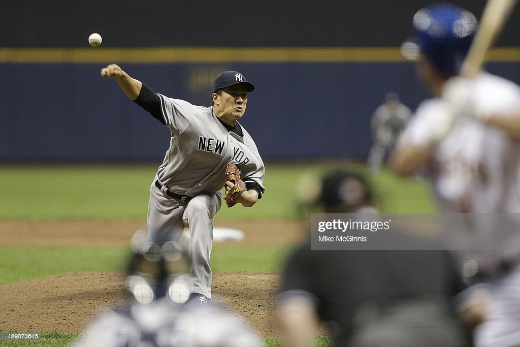 <a gi-track='captionPersonalityLinkClicked' href=/galleries/search?phrase=Masahiro+Tanaka&family=editorial&specificpeople=5492836 ng-click='$event.stopPropagation()'>Masahiro Tanaka</a> #19 of the New York Yankees pitches during the bottom of the third inning during interleague game against the Milwaukee Brewers at Miller Park on May 09, 2014 in Milwaukee, Wisconsin.