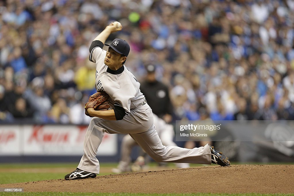 <a gi-track='captionPersonalityLinkClicked' href=/galleries/search?phrase=Masahiro+Tanaka&family=editorial&specificpeople=5492836 ng-click='$event.stopPropagation()'>Masahiro Tanaka</a> #19 of the New York Yankees pitches during the top of the first inning during interleague game against the Milwaukee Brewers at Miller Park on May 09, 2014 in Milwaukee, Wisconsin.