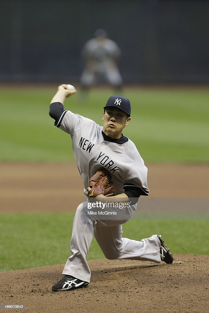<a gi-track='captionPersonalityLinkClicked' href=/galleries/search?phrase=Masahiro+Tanaka&family=editorial&specificpeople=5492836 ng-click='$event.stopPropagation()'>Masahiro Tanaka</a> #19 of the New York Yankees pitches in the bottom of the second inning during interleague game against the Milwaukee Brewers at Miller Park on May 09, 2014 in Milwaukee, Wisconsin.