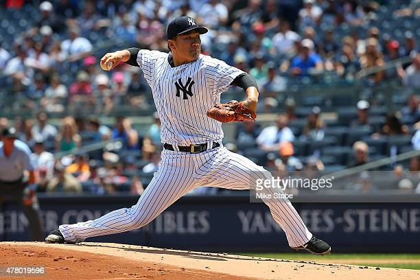 Masahiro Tanaka of the New York Yankees pitches in the first inning against the Detroit Tigers at Yankee Stadium on June 21 2015 in the Bronx borough...