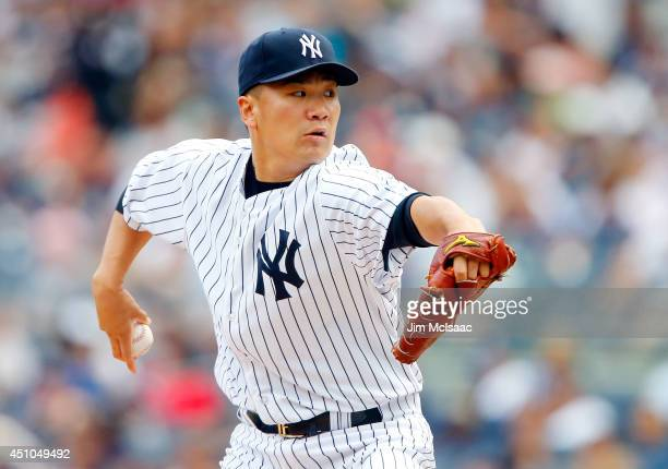Masahiro Tanaka of the New York Yankees pitches in the second inning against the Baltimore Orioles at Yankee Stadium on June 22 2014 in the Bronx...