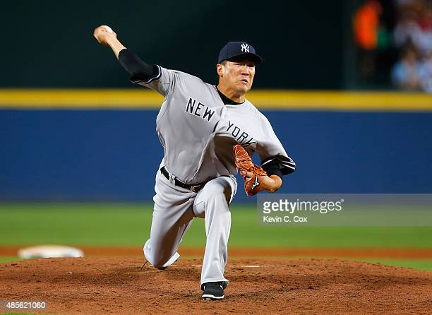 Masahiro Tanaka of the New York Yankees pitches in the second inning to the Atlanta Braves at Turner Field on August 28 2015 in Atlanta Georgia