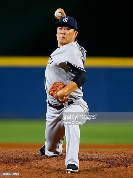 Masahiro Tanaka of the New York Yankees pitches to the Atlanta Braves in the second inning at Turner Field on August 28 2015 in Atlanta Georgia