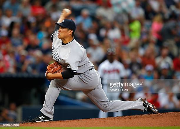 Masahiro Tanaka of the New York Yankees pitches to the Atlanta Braves in the first inning at Turner Field on August 28 2015 in Atlanta Georgia