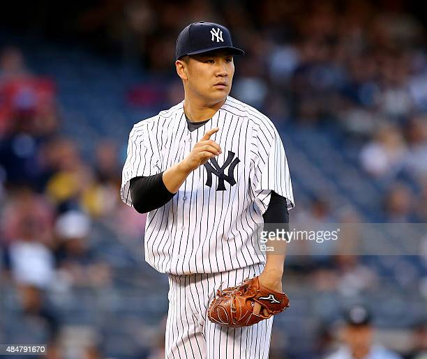 Masahiro Tanaka of the New York Yankees points to Stephen Drew after Drew made the play for the out in the second inning against the Cleveland...