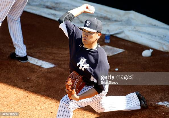 Masahiro Tanaka of the New York Yankees practices in the bullpen during a workout on March 4 2015 at Steinbrenner Field in Tampa Florida