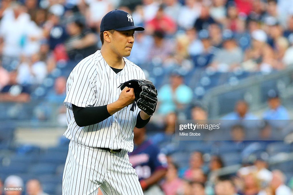 <a gi-track='captionPersonalityLinkClicked' href=/galleries/search?phrase=Masahiro+Tanaka&family=editorial&specificpeople=5492836 ng-click='$event.stopPropagation()'>Masahiro Tanaka</a> #19 of the New York Yankees pumps his fist into his glove afater getting the final out of the first inning aginst the Minnesota Twins at Yankee Stadium on June 24, 2016 in the Bronx borough of New York City. Boston