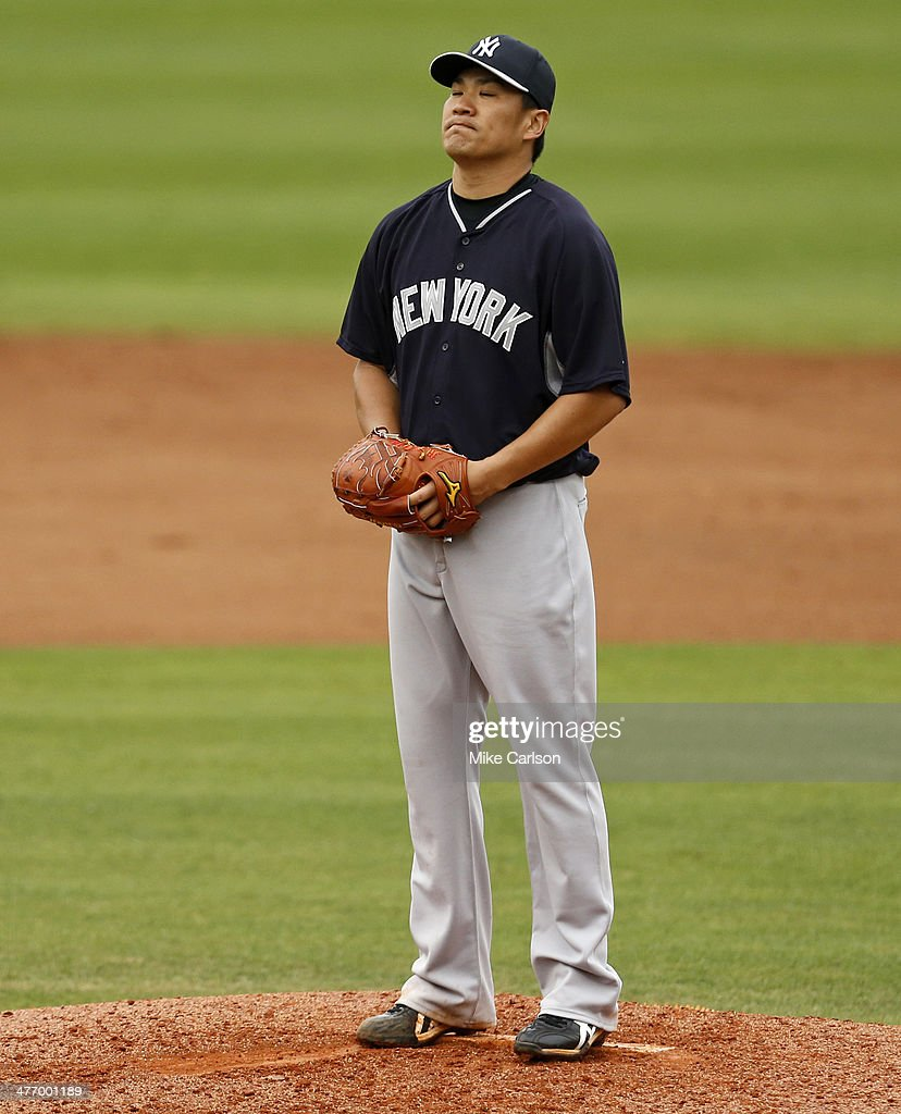 <a gi-track='captionPersonalityLinkClicked' href=/galleries/search?phrase=Masahiro+Tanaka&family=editorial&specificpeople=5492836 ng-click='$event.stopPropagation()'>Masahiro Tanaka</a> #19 of the New York Yankees reacts after giving up a home run to Freddy Galvis of the Philadelphia Phillies during a spring training game at Bright House Field on March 6, 2014 in Clearwater, Florida.