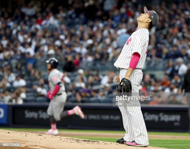 Masahiro Tanaka of the New York Yankees reacts after giving up a solo home run to George Springer of the Houston Astros in the first inning in Game 2...
