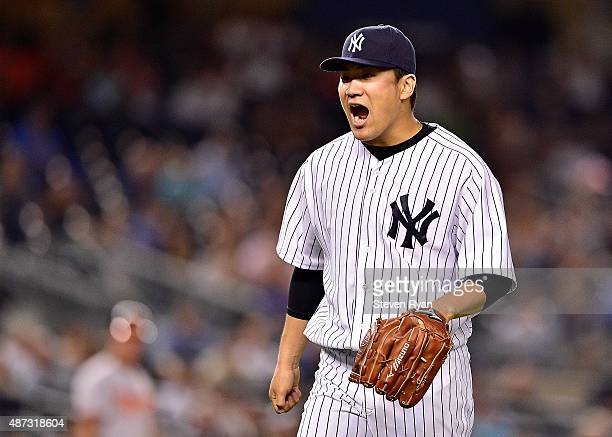 Masahiro Tanaka of the New York Yankees reacts after retiring the side in the fifth inning against the Baltimore Orioles at Yankee Stadium on...
