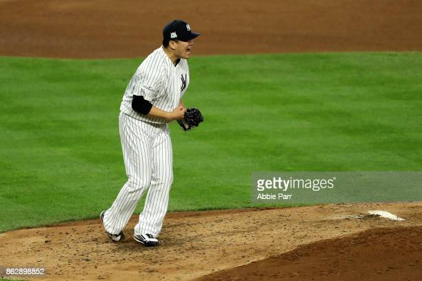 Masahiro Tanaka of the New York Yankees reacts after striking out Josh Reddick of the Houston Astros to end the top of the fifth inning in Game Five...