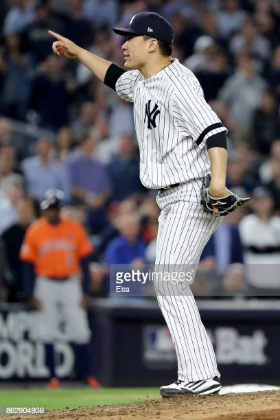 Masahiro Tanaka of the New York Yankees reacts after striking out Carlos Beltran of the Houston Astros during the seventh inning in Game Five of the...