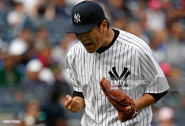 Masahiro Tanaka of the New York Yankees reacts after the final out in the seventh inning against the Toronto Blue Jays at Yankee Stadium on September...