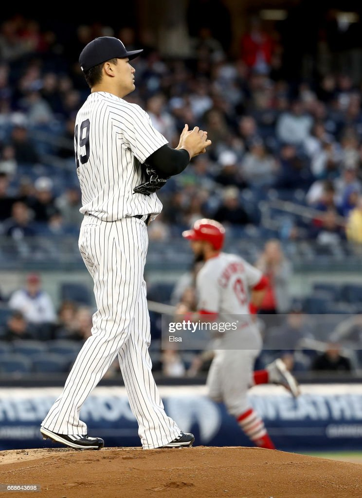 Masahiro Tanaka #19 of the New York Yankees reacts as Matt Carpenter #13 of the St. Louis Cardinals rounds third base after a two run home run in the first inning on April 14, 2017 at Yankee Stadium in the Bronx borough of New York City.