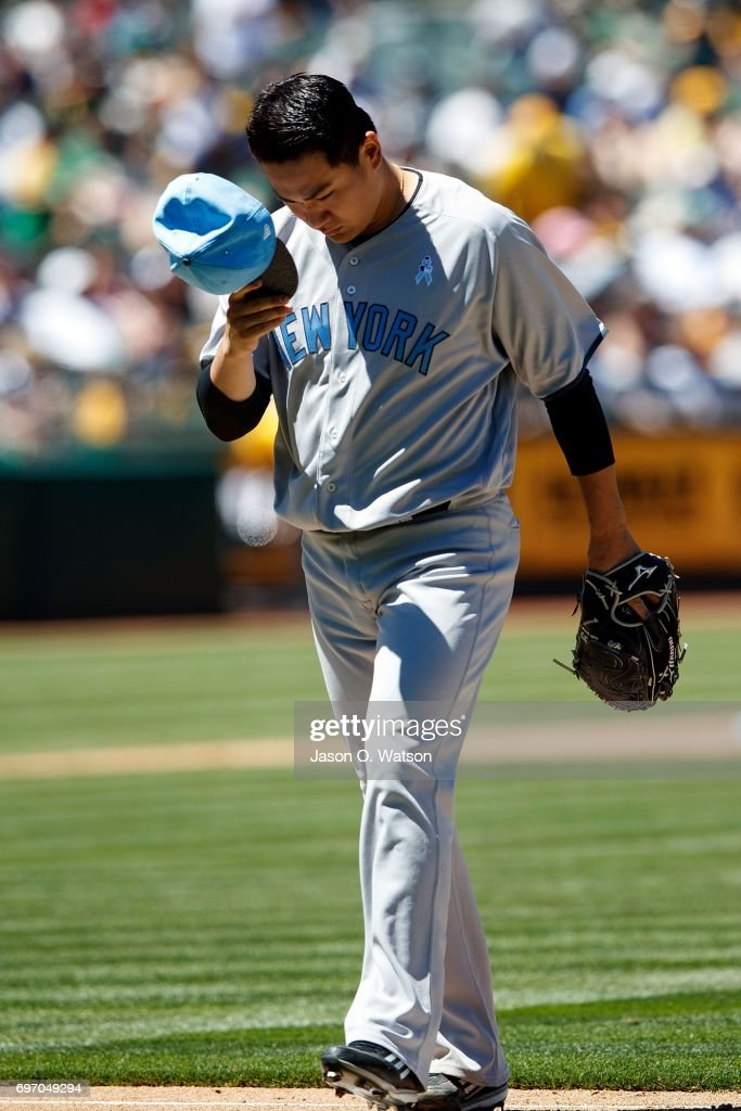 Masahiro Tanaka #19 of the New York Yankees returns to the dugout during the fourth inning against the Oakland Athletics at the Oakland Coliseum on June 17, 2017 in Oakland, California. The Oakland Athletics defeated the New York Yankees 5-2. Players and umpires are wearing blue to celebrate Father's Day weekend and support prostrate cancer awareness.
