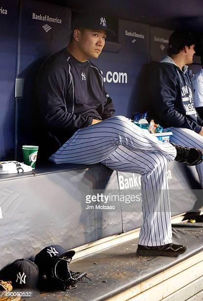 Masahiro Tanaka of the New York Yankees sits in the dugout during the sixth inning of a game against the Chicago White Sox at Yankee Stadium on...