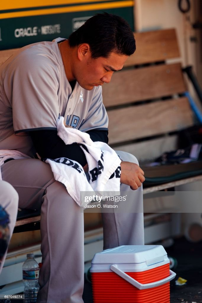 Masahiro Tanaka #19 of the New York Yankees sits in the dugout during the fifth inning against the Oakland Athletics at the Oakland Coliseum on June 17, 2017 in Oakland, California. The Oakland Athletics defeated the New York Yankees 5-2. Players and umpires are wearing blue to celebrate Father's Day weekend and support prostrate cancer awareness.