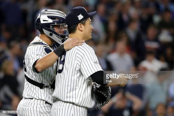 Masahiro Tanaka of the New York Yankees speaks to Gary Sanchez during the fifth inning against the Houston Astros in Game Five of the American League...