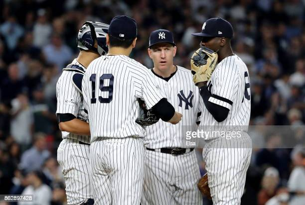 Masahiro Tanaka of the New York Yankees speaks to Gary Sanchez Todd Frazier and Didi Gregorius during the fifth inning against the Houston Astros in...