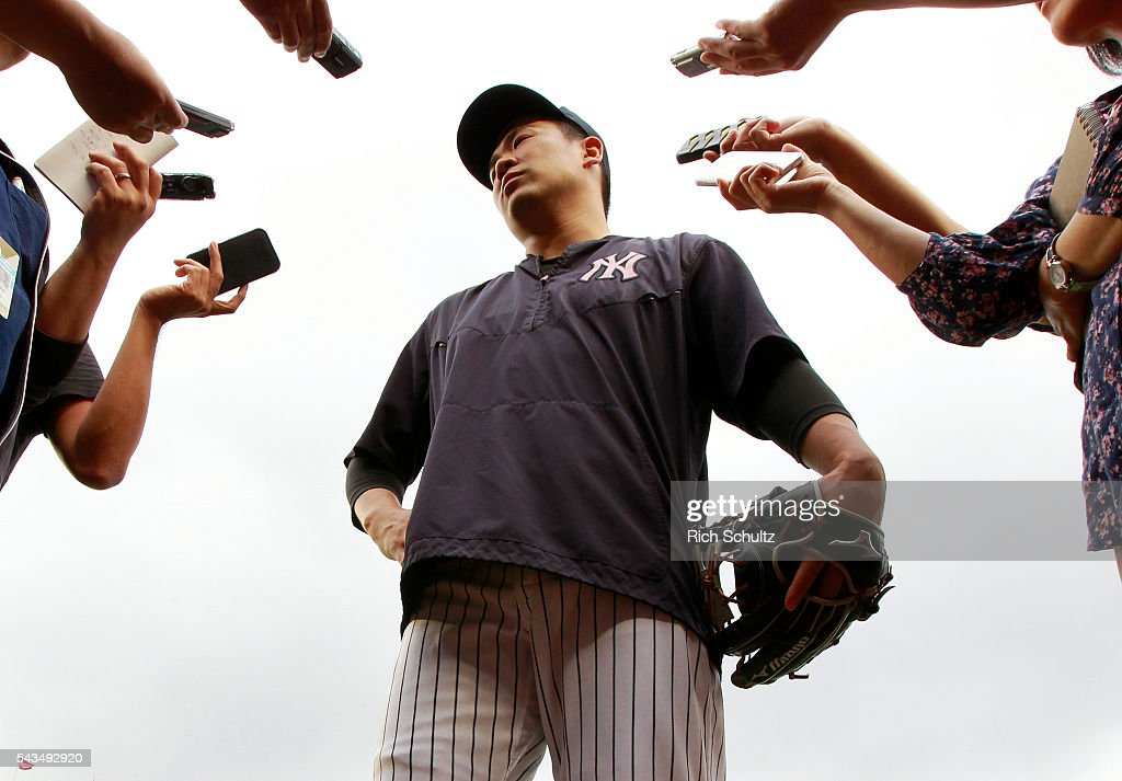<a gi-track='captionPersonalityLinkClicked' href=/galleries/search?phrase=Masahiro+Tanaka&family=editorial&specificpeople=5492836 ng-click='$event.stopPropagation()'>Masahiro Tanaka</a> #19 of the New York Yankees talks with the media before the start of a game against the Texas Rangers at Yankee Stadium on June 28, 2016 in the Bronx borough of New York City.