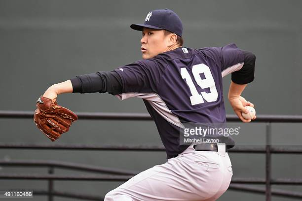 Masahiro Tanaka of the New York Yankees throws a bullpen session before game two of a baseball game against the Baltimore Orioles at Oriole Park at...