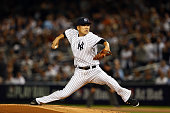 Masahiro Tanaka of the New York Yankees throws a pitch in the first inning against Jose Altuve of the Houston Astros during the American League Wild...