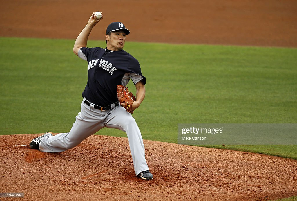 Masahiro Tanaka #19 of the New York Yankees throws during a spring training game against the Philadelphia Phillies at Bright House Field on March 6, 2014 in Clearwater, Florida.