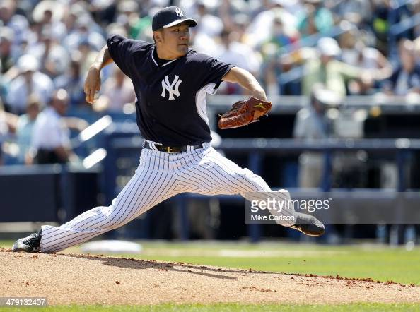 Masahiro Tanaka of the New York Yankees throws during a spring training game against the Atlanta Braves at George M Steinbrenner Field on March 16...