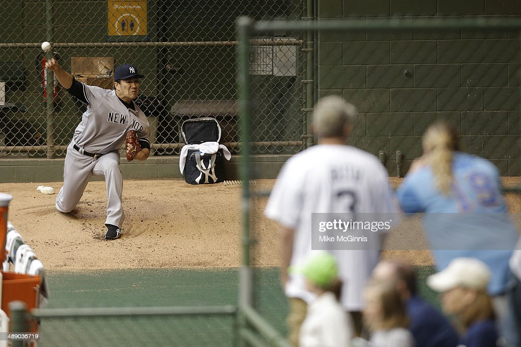 <a gi-track='captionPersonalityLinkClicked' href=/galleries/search?phrase=Masahiro+Tanaka&family=editorial&specificpeople=5492836 ng-click='$event.stopPropagation()'>Masahiro Tanaka</a> #19 of the New York Yankees throws in the bullpen before the inter league game against the Milwaukee Brewers at Miller Park on May 09, 2014 in Milwaukee, Wisconsin.