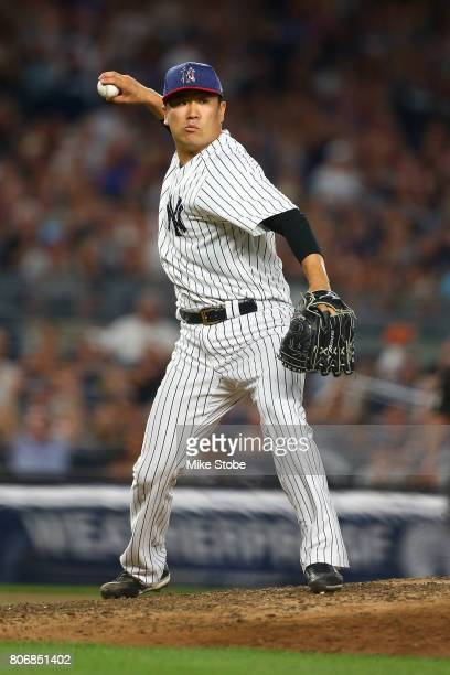 Masahiro Tanaka of the New York Yankees throws the ball to first base after fielding a ground ball off the bat Luke Maile of the Toronto Blue Jays...